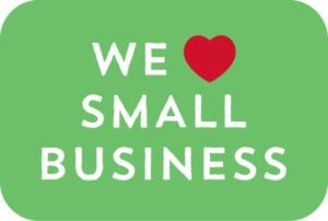Text in image we love small business with a red love heart